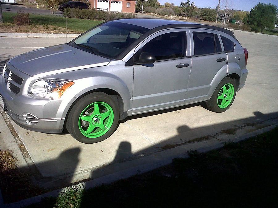 Bright green rims on car
